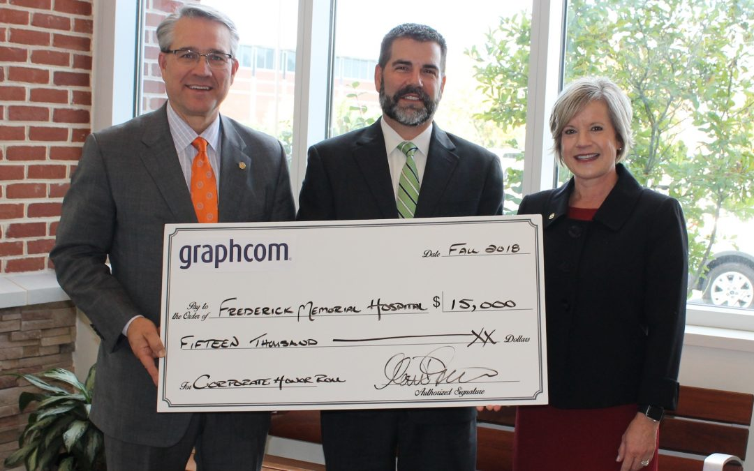 matt livelsberger presents graphcom donation to FMH
