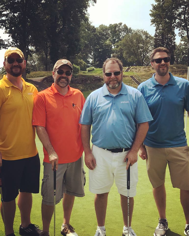 troy dean, matt livelsberger, and dave sandoe at UGI golf event with client