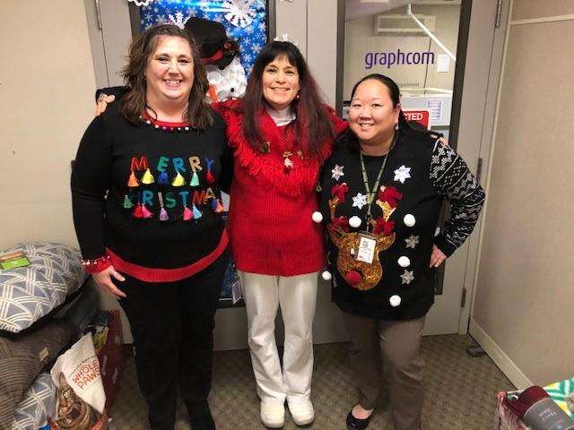 graphcom employees wearing holiday sweaters