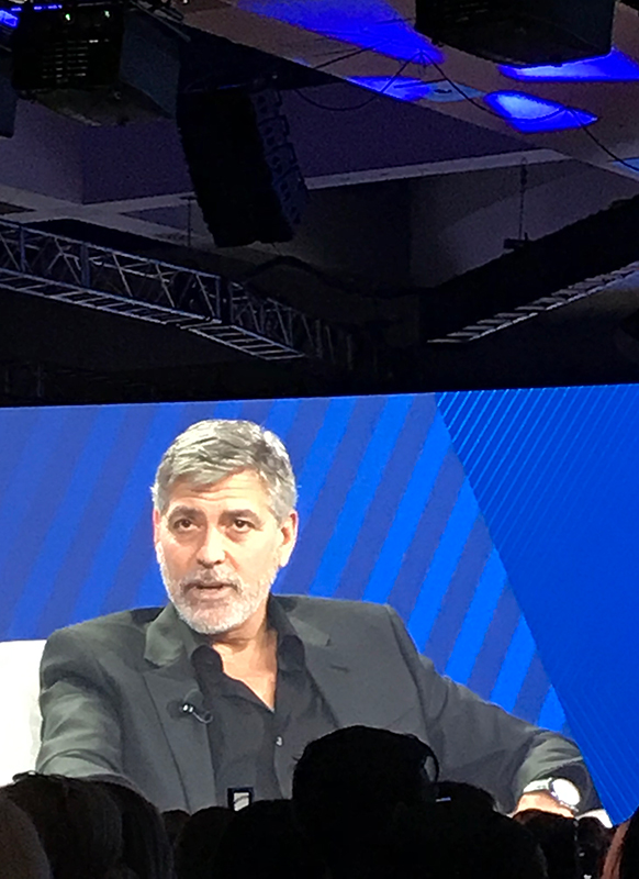 george clooney speaking to the audience at workhuman event