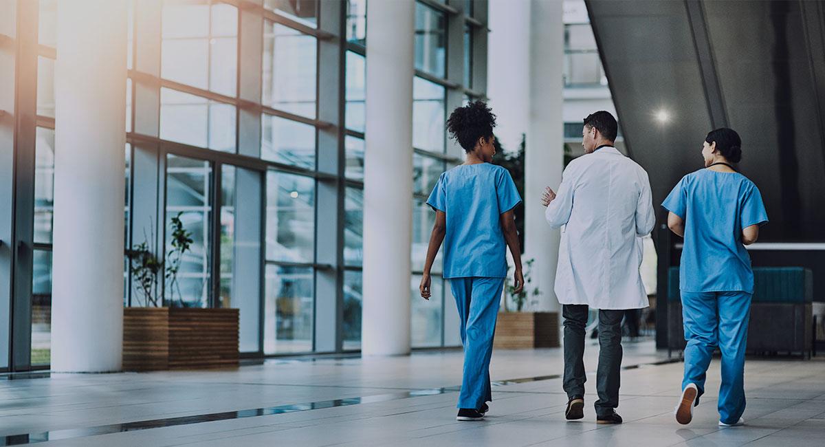 hospital doctors walking down a hallway