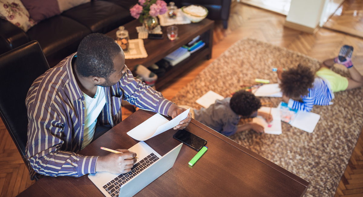 father working from home with children